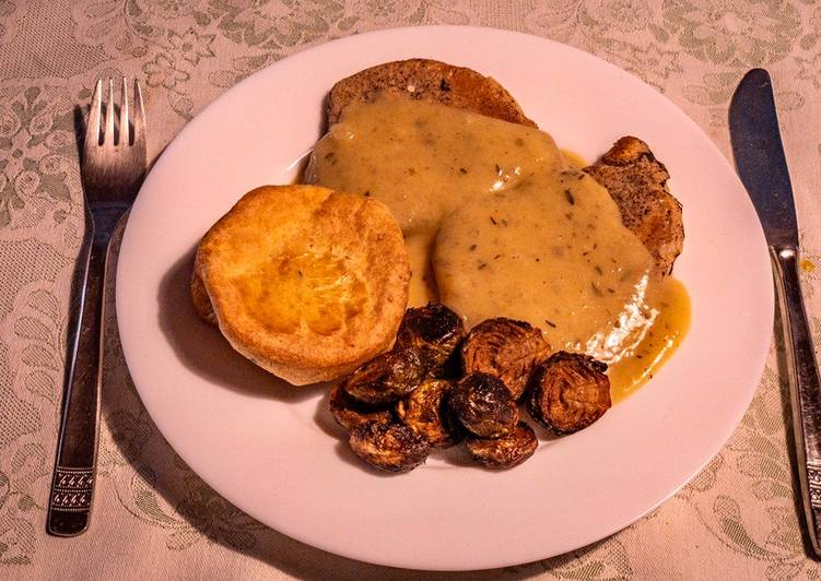 fried chop in cognac gravy sauce with yorkshire pudding and baked brussel sprouts recipe main photo
