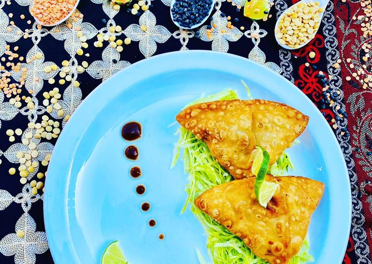 homemade fresh samosa served on bed of lettuce with tamarind sauce and limes recipe main photo