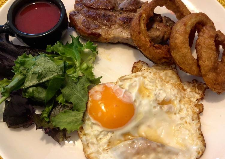 shoulder steak with homemade gooseberry and beetroot ketchup fried egg and crispy onion rings recipe main photo